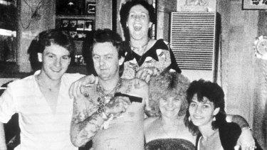 Happy families: Drug dealer and multiple murderer Dennis Allen points a gun at his mother Kath Pettingill's head.