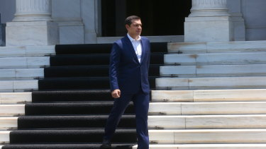 Greek Prime Minister Alexis Tsipras exits his office at the Maximos Mansion last week.