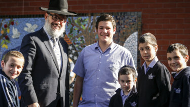Yeshivah principal Rabbi Yehoshua Smukler with some students in 2015.