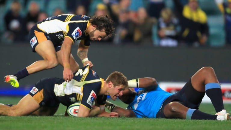 Long night at the office: Kyle Godwin scores for the Brumbies at Allianz Stadium.