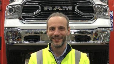 John Di Berardino with a Ram pick-up truck.