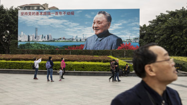 A billboard featuring an image of China's former leader Deng Xiaoping is part of celebrations marking the 40th anniversary of market reforms.