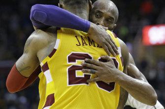 Kobe Bryant hugs LeBron James
