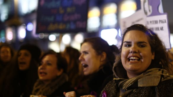 People protest during a women's demonstration at the Puerta del Sol in Madrid on Tuesday.