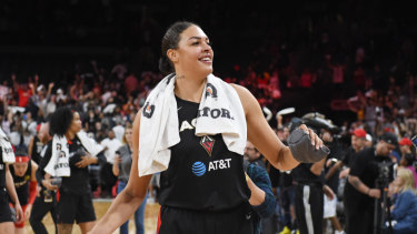 Liz Cambage throws t-shirts into the crowd after helping keeping Las Vegas' season alive.