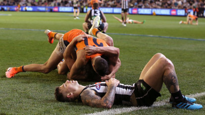Giants stare down Collingwood and army of 75,000 to reach grand final