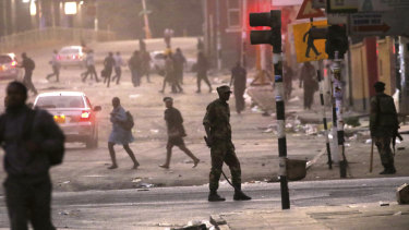 Hundreds of angry opposition supporters outside Zimbabwe's electoral commission were met by riot police firing tear gas as the country awaited the results of Monday's presidential election, the first after the fall of longtime leader Robert Mugabe.