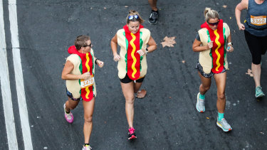 Three women ran the SMH Half Marathon in hot dog suits.