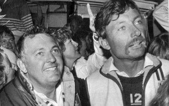 Alan Bond, head of the Australia II syndicate gives the thumbs up as he and skipper, John Bertrand are surrounded by fans following their victory over the America's Cup defender Liberty in 1983.