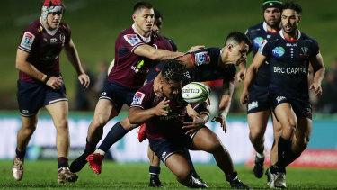 Matt Toomua tackles Brandon Paenga-Amosa during a drawn match in Super Rugby AU last year.
