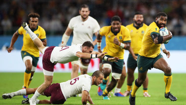Marika Koroibete of Australia breaks through Soso Matiashvili and Vasil Lobzhanidze of Georgia to go on and score his team's second try during the Rugby World Cup 2019 Group D game between Australia and Georgia.