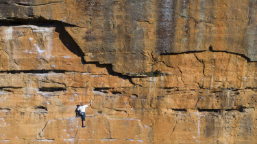 Everest veteran Greg Mortimer scales the western face of Upper Shipley in the Blue Mountains.