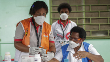 Medical staff in a health clinic in Papua New Guinea, which recorded its eighth COVID-19 case.