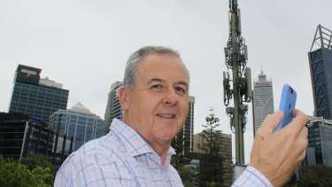 Telstra WA area general manager Boyd Brown testing the 5G signal in Perth.