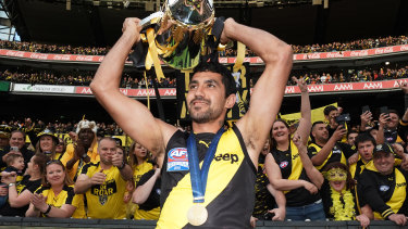 A story that will resonate for generations: Marlion Pickett with the premiership cup.