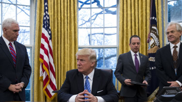 Peter Navarro (far right) in the Oval Office in 2017  with (from left) US Vice-President Mike Pence, President Donald Trump and then White House chief of staff Reince Priebus.