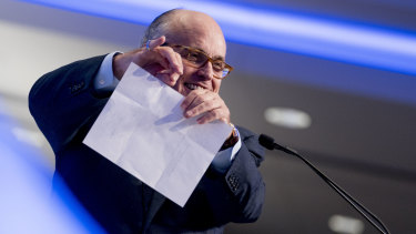 Donald Trump's lawyer Rudy Giuliani pretends to tear a piece of paper as he speaks about the Iran nuclear agreement at a Washington hotel in May.