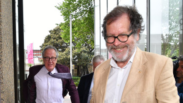 Theatre director Neil Armfield, right, leaves the Federal Court on Wednesday with Geoffrey Rush.