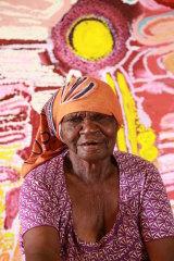 Jakayu Biljabu of Martumili Artists East Pilbara Art Centre in front  of her work, Wilkiri, 2014.