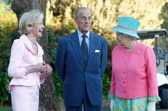 The Queen talks to governor-general Quentin Bryce and Prince Philip after she toured the Government House gardens in Canberra and planted a tree, in October 2011.
