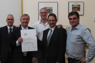 Senator Alex Gallacher holding the Road Safety Remuneration Bill 2012 he fought for. Pictured with (from left) TWU officials Michael Kaine and Tony Sheldon, senator Glenn Sterle and truck driver Frank Black.