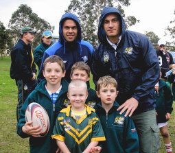 A young Cameron Murray (left, holding the ball) with Sonny Bill Williams (right) at a school clinic.