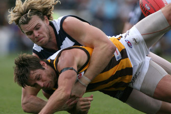 Cameron Mooney wrapped up Shane Crawford in a thumping tackle the last time the Hwks visited Kardinia Park, in 2006.