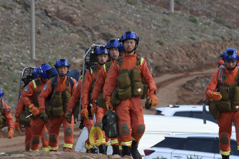 Rescuers walk into the accident site to search for survivors in Jingtai County of Baiyin City, northwest China's Gansu Province.