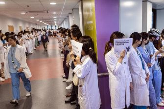 Medical workers hold signs during a protest organised by the medical sector at Queen Mary Hospital in Hong Kong, in September.