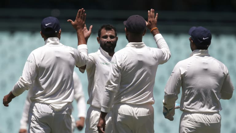 High five: Mohammed Shami, second left, celebrates after taking a wicket in the tour match in Sydney.
