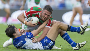 Absorbing battle: Bulldogs half Lachlan Lewis locks horns with Souths skipper Sam Burgess.