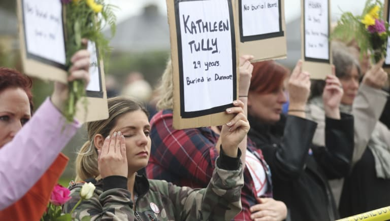 Protesters hold up the names of children at the site of the former Tuam home for unmarried mothers in County Galway on Sunday. The protest was timed to coincide with a visit to Ireland by Pope Francis.