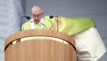 Pope Francis issues an apology to victims of abuse in Ireland at the start of Mass on Sunday.