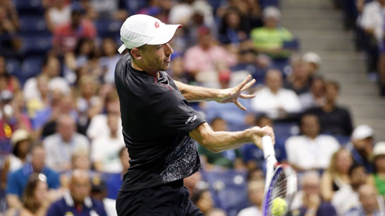 Power and passion: Millman unleashes a forehand in his memorable win.
