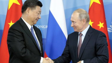 Russian President Vladimir Putin, right, shakes hands with Chinese President Xi Jinping after their news conference at the Eastern Economic Forum in Vladivostok, Russia,