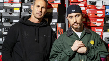Scott Cutler, left, chief executive of StockX, and Josh Luber, founder, in the company's storage room in Detroit,