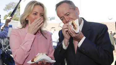 Bill and Chloe Shorten enjoy an election day sausage.