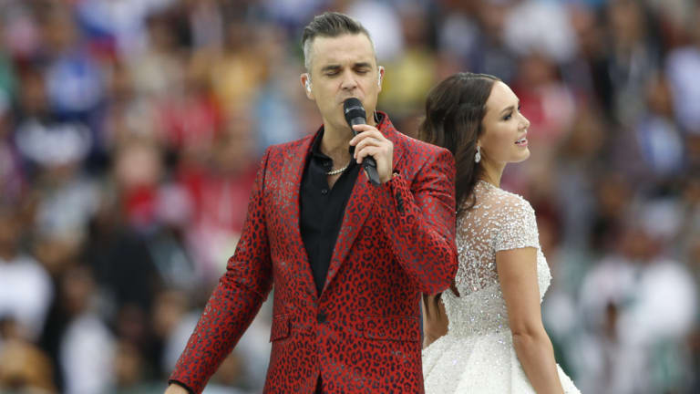 Duet: Robbie Williams and Aida Garifullina sing prior to the opening match.