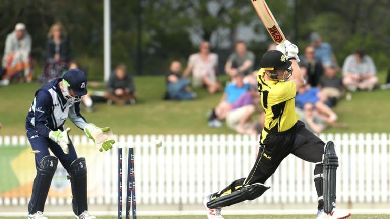 Got him: Western Australia's Cameron Green is bowled by Nic Maddinson.