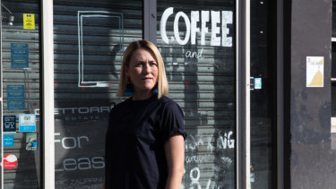 Amelia Birch outside her former business, The Book Kitchen, which closed down because of the light rail construction on Devonshire Street, Surry Hills.