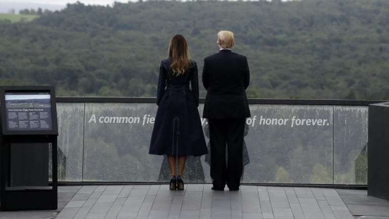 President Donald Trump and first lady Melania Trump, stand at a memorial site in Pennsylvania.