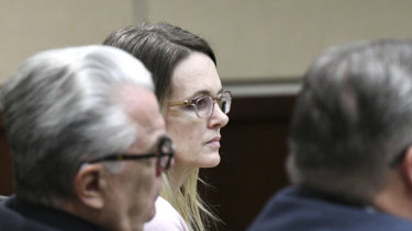 Denise Williams listens to opening statements made by prosecutors during her trial on Tuesday.
