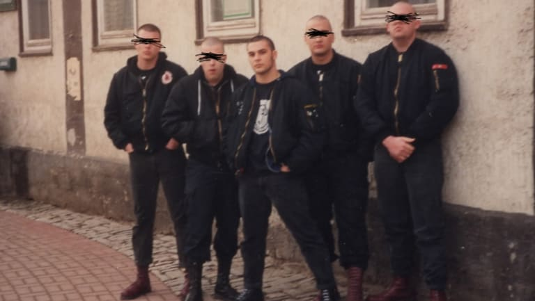 Picciolini (centre) with his band, Final Solution. They were performing in Weimar, Germany, in the 1990s.