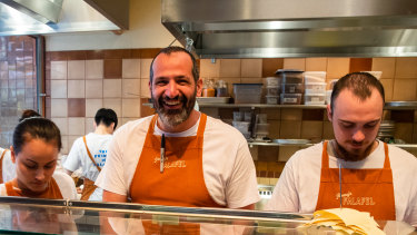 Former Rockpool chef Simon Zalloua (middle) on the tools at Jimmy's Falafel.