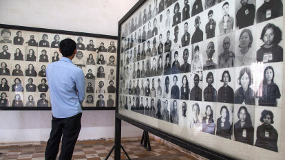 Cambodia condemns artist who added smiles to Khmer Rouge victims