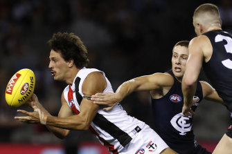Ben Long gets the ball away for the Saints in their win over Carlton on Thursday night.