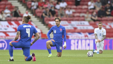 England's Jack Grealish takes a knee before the international friendly soccer match between England and Romania.