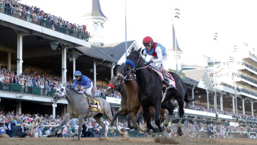 Medina Spirit crosses the line to give trainer Bob Baffert his seventh Kentucky Derby winner.