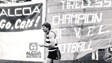 John 'Sam' Newman breaks through the banner for his 300th VFL game.