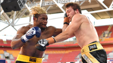 Brisbane bout: Christian Ndzie Tsoye (left) lands a punch on Joseph Goodall during their heavyweight fight at Suncorp Stadium in November.